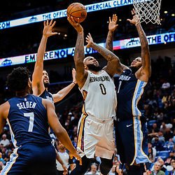 Jan 20, 2018; New Orleans, LA, USA; New Orleans Pelicans center DeMarcus Cousins (0) shoots over Memphis Grizzlies forward Jarell Martin (1) and center Marc Gasol (33) and guard Wayne Selden (7) during the second half at the Smoothie King Center. The Pelicans defeated the Grizzlies 111-104. Mandatory Credit: Derick E. Hingle-USA TODAY Sports