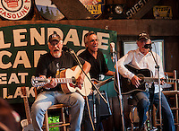 """Drew Seneca, Carl Deprospo and Tom Dunfee play a session during """"Duanestock"""" held in Duane Johnson's 133 year old barn on Saturday evening.  (Karen Bobotas/for the Laconia Daily Sun)"""