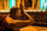 Stoked to be back in Myanmar! <br /> <br /> A monk prays at Shwedagon Pagoda, the country&rsquo;s holiest site, as hundreds of candles are lit around it to celebrate Earth Hour.