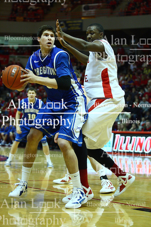 13 January 2012:  Doug McDermott backs into the lane guarded by John Wilkins during an NCAA Missouri Valley Conference mens basketball game where the Creighton Bluejays topped the Illinois State Redbirds 87-78 in Redbird Arena, Normal IL