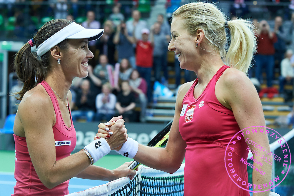 (L) Martina Hingis from Switzerland congrats to (R) Urszula Radwanska of Poland after her winning game during the Fed Cup / World Group Play Off tennis match between Poland and Switzerland on April 19, 2015 in Zielona Gora, Poland<br /> Poland, Zielona Gora, April 19, 2015<br /> <br /> Picture also available in RAW (NEF) or TIFF format on special request.<br /> <br /> For editorial use only. Any commercial or promotional use requires permission.<br /> <br /> Adam Nurkiewicz declares that he has no rights to the image of people at the photographs of his authorship.<br /> <br /> Mandatory credit:<br /> Photo by &copy; Adam Nurkiewicz / Mediasport
