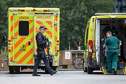 © Licensed to London News Pictures. 14/08/2018. London, UK. Armed police outside the A&E entrance to St Thomas's hospital in Westminster after a car crashed into security barriers in Parliament Square. Photo credit: Rob Pinney/LNP