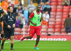 13.09.2014, Anfield, Liverpool, ENG, Premier League, FC Liverpool vs Aston Villa, 4. Runde, im Bild Liverpool's Mario Balotelli runs out at Anfield for the first time as he warms-up // during the English Premier League 4th round match between Liverpool FC and Aston Villa at the Anfield in Liverpool, Great Britain on 2014/09/13. EXPA Pictures © 2014, PhotoCredit: EXPA/ Propagandaphoto/ David Rawcliffe<br /> <br /> *****ATTENTION - OUT of ENG, GBR*****