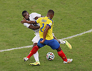 Jorge Guagua of Ecuador (2) is challenged by Blaise Matuidi of France (14) during the 2014 FIFA World Cup Group E match at Maracana Stadium, Rio de Janeiro<br /> Picture by Andrew Tobin/Focus Images Ltd +44 7710 761829<br /> 25/06/2014