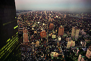 New York City, at dusk, from the World Trade Center, looking north towards the Empire State Building in the center of Manhattan. USA.