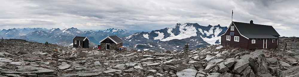 Fannaråkhytta (2068 meters or 6785 feet elevation) is Norway's highest tourist lodge. Hike Fannaråken mountain in Jotunheimen National Park, Norway. Walk 15 kilometers round trip with 1170 meters gain from Turtagrø Mountain Hotel to Fannaråken mountain (or Fannaråki, 2068-meters / 6785 feet elevation) in Luster municipality, Sogn og Fjordane county, Norway. Marvel at views eastwards over the Fanaråkbreen glacier to the Smørstabb massif, to more Jotunheimen peaks beyond, and southwards to the huge north face of the connected Styggedals and Skagastøls ridges in the Hurrungane Range. Panorama stitched from 5 overlapping photos.