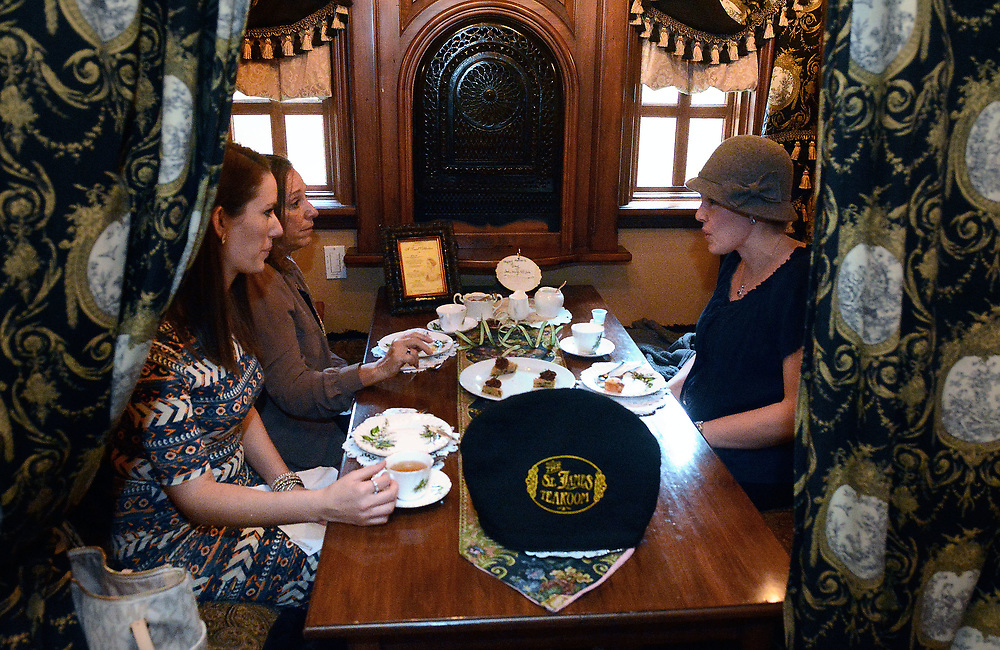 jt050917i/biz/jim thompson/  left to to right- Mary Thomas, Janet Coakley and Jana Coakley enjoy a spot of tea for their early Mother's Day celebration at the St. James Tearoom. Tuesday May. 09, 2017. (Jim Thompson/Albuquerque Journal)