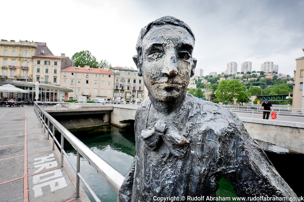 Sculpture of Croatian avant-garde writer and satirist Janko Polic Kamov on a bridge by the Hotel Continental, Rijeka, Croatia. Kamov was born just round the corner in the suburb of Su?ak in 1886.