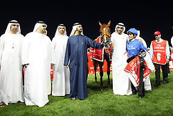 Silvestre De Sousa, the jockey of African Story, celebrates his $10,000,000 Dubai World Cup race win with Sheikh Mohammed bin Rashid Al Maktoum, UAE prime minister and ruler of Dubai (C, in blue), and Sheikh Hamdan Bin Mohammed Bin Rashid Al Maktoum, Dubai crown prince, (3rd from R) at the Meydan in Dubai, United Arab Emirates, Saturday March 29, 2014. With a total prize purse of US$27.25 million, the 19th running of Dubai World Cup is the world's richest day of racing. Picture by Randi Sokoloff / i-Images