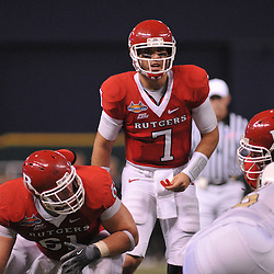 Dec 19, 2009; St. Petersburg, Fla., USA; Rutgers quarterback Tom Savage (7) looks over the defense from behind center Ryan Blaszczyk (61) during NCAA Football action in Rutgers' 45-24 victory over Central Florida in the St. Petersburg Bowl at Tropicana Field.