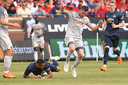 July 28, 2018 - Ann Arbor, MI, U.S. - ANN ARBOR, MI - JULY 28: Manchester United Forward Alexis Sanchez (7) falls on the ball while battling with Liverpool Midfielder James Milner (7) in the ICC soccer match between Manchester United FC and Liverpool FC on July 28, 2018 at Michigan Stadium in Ann Arbor, MI. (Photo by Allan Dranberg/Icon Sportswire) (Credit Image: © Allan Dranberg/Icon SMI via ZUMA Press)