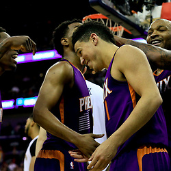 Nov 4, 2016; New Orleans, LA, USA; Phoenix Suns guard Devin Booker (1) celebrates with teammates after scoring in overtime of a game against the New Orleans Pelicans at the Smoothie King Center. The Suns defeated the Pelicans 112-111 in overtime. Mandatory Credit: Derick E. Hingle-USA TODAY Sports