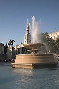 Water fountain, Trafalgar Square, London, England with Saint Martin in the Fields church