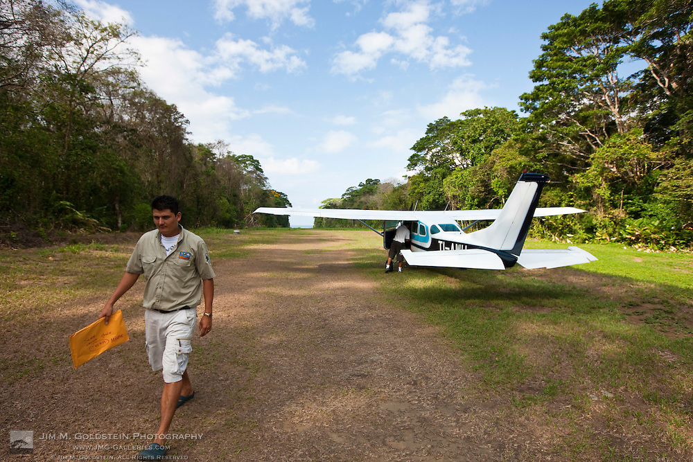 A ranger receives mail at the airstrip at the Sirena Biological Station in Corcovado National Park, Costa Rica