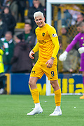 Lyndon Dykes (#9) of Livingston FC celebrates in front of the Celtic fans after he scores Livingston's second goal during the Ladbrokes Scottish Premiership match between Livingston FC and Celtic FC at The Tony Macaroni Arena, Livingston, Scotland on 6 October 2019.