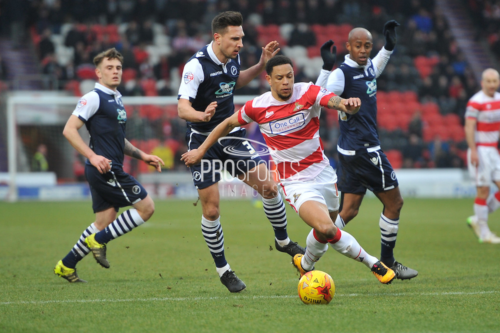 Nathan Tyson of Doncaster Rovers makes his way up field during the Sky Bet League 1 match between Doncaster Rovers and Millwall at the Keepmoat Stadium, Doncaster, England on 27 February 2016. Photo by Ian Lyall.