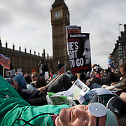 At the sound of Big Ben striking 1 protestors laid down on the bridge pretending to be dead..The Health and Care Bill has been passed by Parliament and is due to go to the House of Lords. In protest against the bill which aim to deconstruct and privatise large parts of the NHS UK Uncut activists together with health workers and trade unionists blocked the Westminster Bridge from 1pm til 5.30pm.