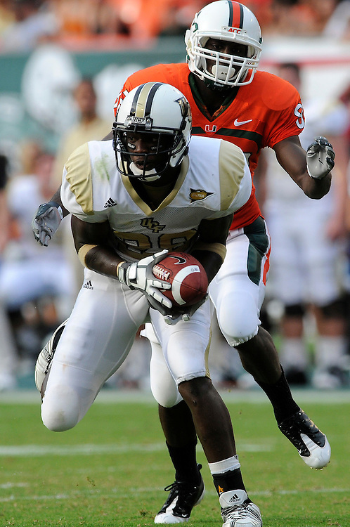 October 11, 2008 - Miami Gardens, FL<br /> <br /> University of Central Florida defensive back Sha'reff Rashad intercepts a pass intended for University of Miami wide receiver Kayne Farquharson during the Hurricanes 20-14 victory over the Knights at Dolphin Stadium in Miami Gardens, Florida.<br /> <br /> JC Ridley/CSM