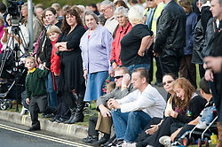© licensed to London News Pictures. 08/09/2011. Brize Norton, UK..Members of the public line the streets to watch the Body of Sergeant Barry Weston of 42 Commando Royal Marines passes the memorial in Carterton after arriving at RAF Brize Norton for the first time. Sgt Weston was killed on August 30 while leading a patrol near the village of Sukmanda in southern Nahr-e Saraj, Helmand province. Photo credit: Ben Cawthra/LNP