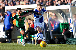 Lee Brown of Bristol Rovers is challenged by Duane Holmes of Scunthorpe United - Rogan/JMP - 24/02/2018 - FOOTBALL - Memorial Stadium - Bristol, England - Bristol Rovers v Scunthorpe United - EFL Sky Bet League One.