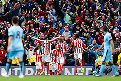 Stoke players celebrate with the away fans after Mame Biram Diouf of Stoke scores a goal to give his side a 0-1 lead - Photo mandatory by-line: Rogan Thomson/JMP - 07966 386802 - 30/08/2014 - SPORT - FOOTBALL - Manchester, England - Etihad Stadium - Manchester City v Stoke City - Barclays Premier League.