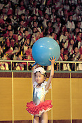 A little girl performs with a ball at a community event heralding the upcoming Beijing Olympics.