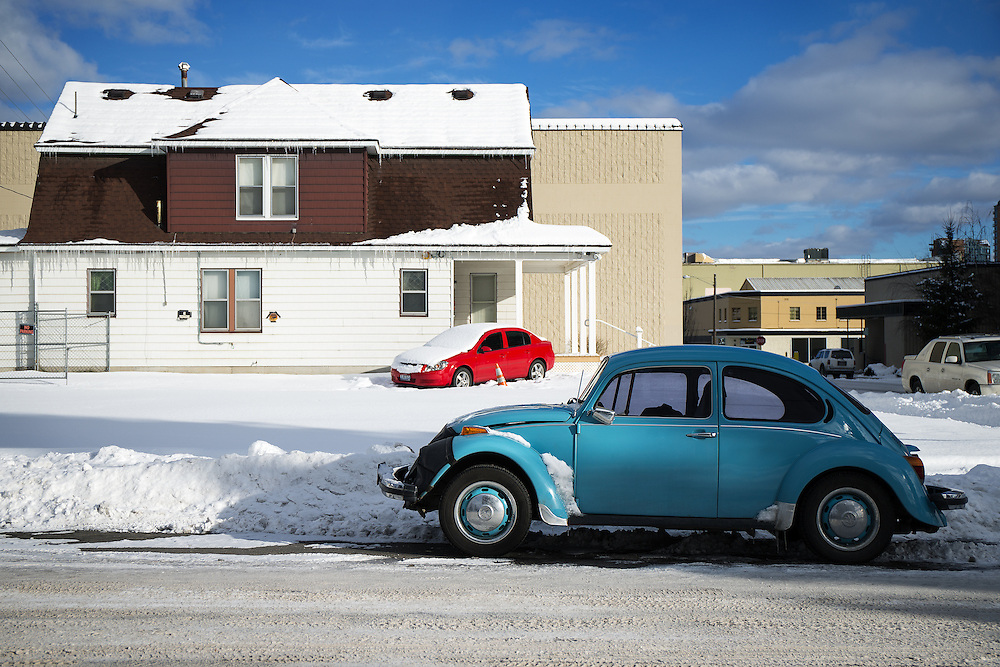 GABE GREEN/Press<br /> <br /> A blue, classic Volkswagen Beetle parked on North First Street is contrasted by a modern, bright red car parked outside a residence in Coeur d&rsquo;Alene Tuesday afternoon.