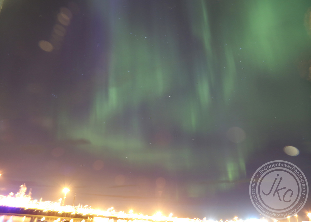 Iceland's Northern Lights dance above Reykjavick Harbor.