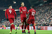 Liverpool striker Sadio Mane (10) celebrates his goal 4-2 with Liverpool defender Virgil van Dijk (4) and Liverpool striker Roberto Firmino (9) during the Premier League match between Liverpool and Crystal Palace at Anfield, Liverpool, England on 19 January 2019.
