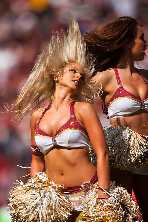 LANDOVER, MD - SEPTEMBER 23:  A member of the Washington Redskins cheerleads performs during the game against the Cincinnati Bengals at FedEx Field on September 23, 2012 in Landover, Maryland. (Photo by Rob Tringali) *** Local Caption ***
