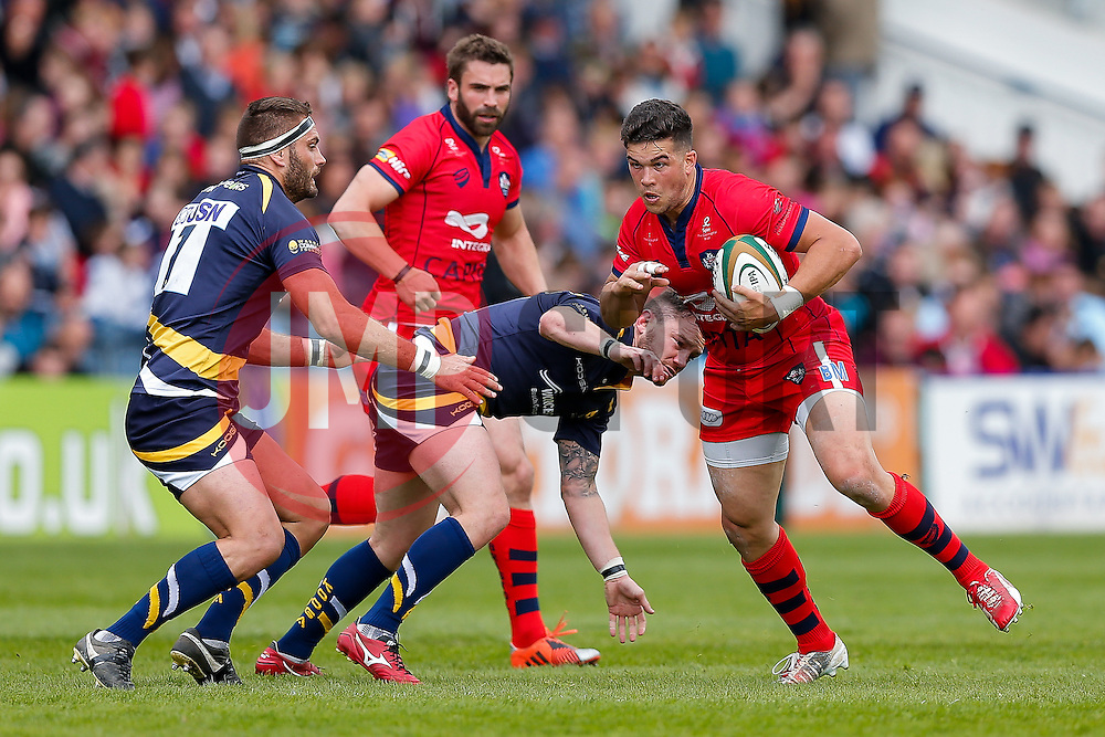 Bristol Rugby Inside Centre Ben Mosses is challenged by Worcester Number 8 GJ van Velze (capt) and Flanker Sam Betty - Photo mandatory by-line: Rogan Thomson/JMP - 07966 386802 - 25/04/2015 - SPORT - Rugby Union - Worcester, England - Sixways Stadium - Worcester Warriors v Bristol Rugby - Greene King IPA Championship.