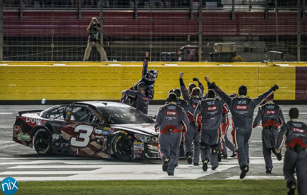 Austin Dillon and his crew celebrate winning the Coca-Cola 600 by sliding across the infield grass at Charlotte Motor Speedway Sunday, May 28, 2017.
