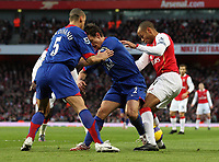 Photo: Paul Thomas.<br /> Arsenal v Manchester United. The Barclays Premiership. 21/01/2007.<br /> <br /> Thierry Henry (R) of Arsenal tries to get through Man Utd's Rio Ferdinand (L) and Gary Neville.