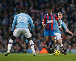 Wilfried Zaha of Crystal Palace (C) in action - Mandatory by-line: Jack Phillips/JMP - 18/01/2020 - FOOTBALL - Etihad Stadium - Manchester, England - Manchester City v Crystal Palace - English Premier League