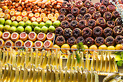 Grocers shop stall selling fresh produce local fruit pineapple oranges, apples, carrots grapefruit in Istanbul, Turkey