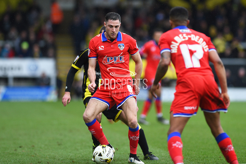 Oldham Athletic midfielder Mike Jones  shields the ball during the Sky Bet League 1 match between Burton Albion and Oldham Athletic at the Pirelli Stadium, Burton upon Trent, England on 26 March 2016. Photo by Jon Hobley.