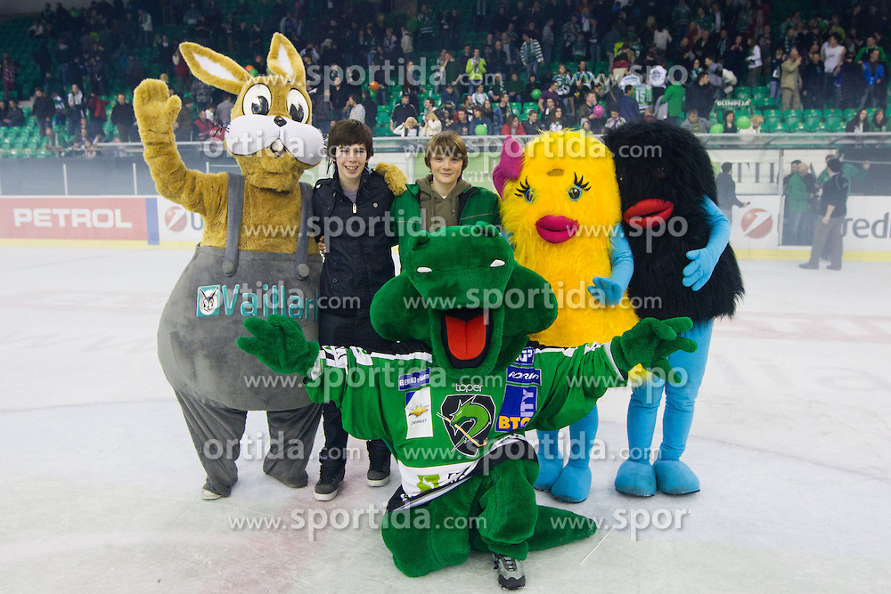 Mascots dragon Hoki, Siol Xobi and bunny Vaillant with two fans during ice-hockey match between HDD Tilia Olimpija and SAPA Fehervar AV19 at sixth match in Quarterfinal  of EBEL league, on March 1, 2012 at Hala Tivoli, Ljubljana, Slovenia. HDD Tilia Olimpija won 4:3 and advanced to semifinal. (Photo By Matic Klansek Velej / Sportida)