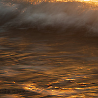 A painterly impression of a sunlit early morning wave.