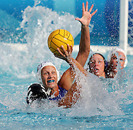 US player Amber Stachowski (11) goes up to shoot as an unidentified Australian player tries to defend in the United States vs Australian bronze medal match in the Women's Water Polol at theOlympicv Aquatic Centre in Athens Thursday 26 August 2004.  The US won 6 to 5.   (Photo by Patrick B. Kraemer / MAGICPBK)