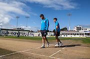 Somerset players Tim Groenewald and Lewis Gregory inspect the pitch after morning rain before play gets under way for the LV County Championship Div 1 match between Sussex County Cricket Club and Somerset County Cricket Club at the BrightonandHoveJobs.com County Ground, Hove, United Kingdom on 14 September 2015. Photo by Bennett Dean.