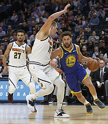 October 21, 2018 - Denver, Colorado, U.S - Warriors KLAY THOMPSON, right, makes a run to the basket  with Nuggets NIKOLA JOKIC, left, during the 1st. Half at the Pepsi Center Sunday night. The Nuggets beat the Warriors 100-98. (Credit Image: © Hector Acevedo/ZUMA Wire)