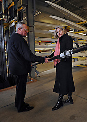 © Licensed to London News Pictures. 27/02/2012, London, UK. (L-R ) IVOR LLOYD Managing Director of Dorney Lake shows Home Secretary Theresa May how light a professional oar is during her visit to Eton College Rowing Centre in Windsor today 27 february 2012 to see the preparations being made ahead of the London Olympic and Paralympic Games. Photo credit : Stephen Simpson/LNP
