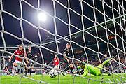 ALKMAAR - 26-09-2015, AZ - Heracles Almelo, AFAS Stadion, 3-1, AZ speler Muamer Tankovic (3vr) scoort hier de 3-1, doelpunt, Heracles Almelo keeper Bram Castro (r).