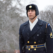 A soldier takes part in the changing of the guard ceremony at the Tomb of the Unknowns at Arlington National Cemetery in the snow. This is the relief commander who overseas the ceremony.