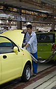 A factory worker builds a QQ model car on the assembly line in the Chery Automobile factory in Wuhu, China, May 16, 2007. Chery Automobile Co Ltd, one of China's fastest-growing carmakers, plans to export 10,000 cars and 10,000 sets of components this year. The Anhui Province-based firm said in a statement Thursday that if the goal is reached, it will be a very great achievement because China exported a total of 2,849 cars last year..More than 600 cars from Chery's five low-end models will be sent to the Middle East and South America this month, including Syria and Kuwait.