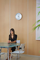Business woman sitting at table in conference room