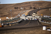 A fortified barricade on the Backwater Bridge on Highway 1806 blocks access to the construction site of the Dakota Access Pipeline near the Oceti Sakowin Camp in Cannon Ball, North Dakota in November 2016.<br /> <br /> The presence of military-grade equipment such as armored humvees and vehicles, barbed wire and cement barricades at the protest site has sparked controversy. The protest site located on land managed by the Army Corps of Engineers, is considered trespassing and subject to prosecution according to the Army Corps.
