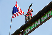 Bree Smith, a journeyman ironworker with Local 29, celebrates after topping out the Knight Cancer Research Building on Monday.