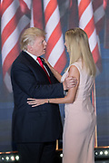 GOP Presidential candidate Donald Trump embraces his daughter Ivanka Trump, as he enters the stage to accept the party nomination for president on the final day of the Republican National Convention July 21, 2016 in Cleveland, Ohio.