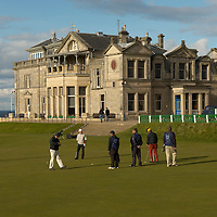 The Links Clubhouse and golfers playing on the Old Course, St Andrews, Scotland